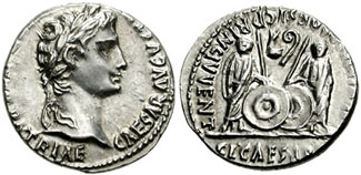 Сребрни новчић цара Августа искован између 2. год. пре н.е. и 14. године н.е. у Лугдунуму (данашњем Лиону) у Галији. На аверсу се види царев лик, а на полеђини су представљени његови унуци, Гај и Луције, са сребрним штитовима. Такође се може видети натпис //principes iuventutis//.