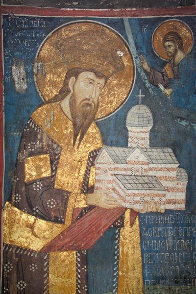Фреска из манастира Дечани на којој је представљен Стефан Дечански као ктитор, са моделом манастира у рукама.